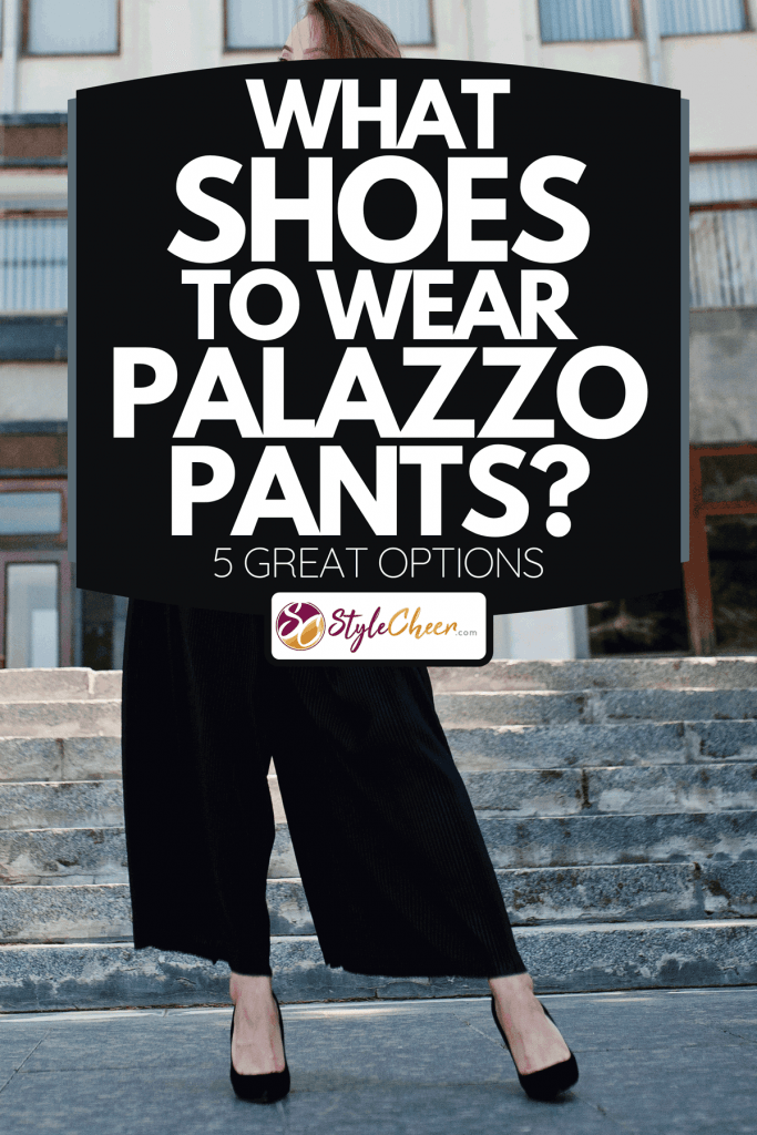 A fabulous woman in white blouse and broad black pants posing on the stairs, What Shoes To Wear With Palazzo Pants? [5 Great Options]