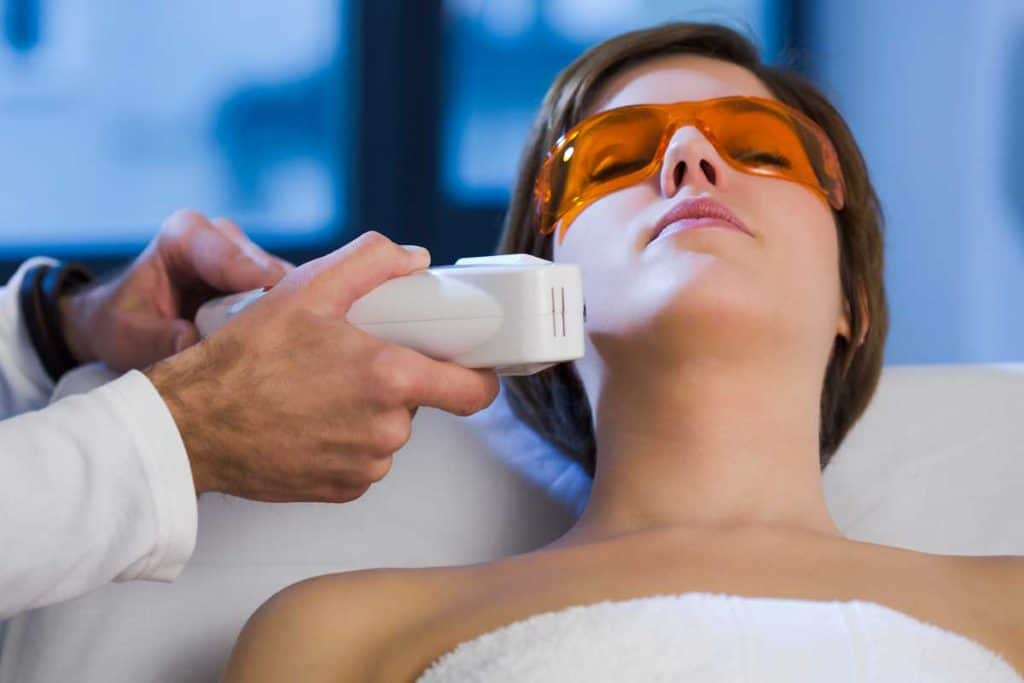 Woman getting electrolysis treatment on her face, Can You Wear Makeup After Electrolysis?
