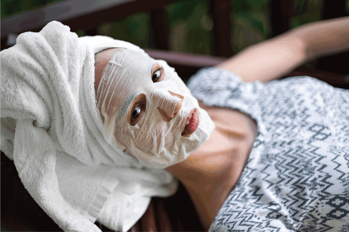 Woman in a disposable cosmetic mask on face