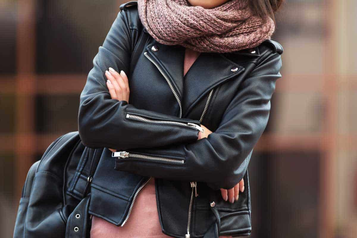 Woman in black leather jacket walking in city street, Are Leather Jackets Good For Winter?