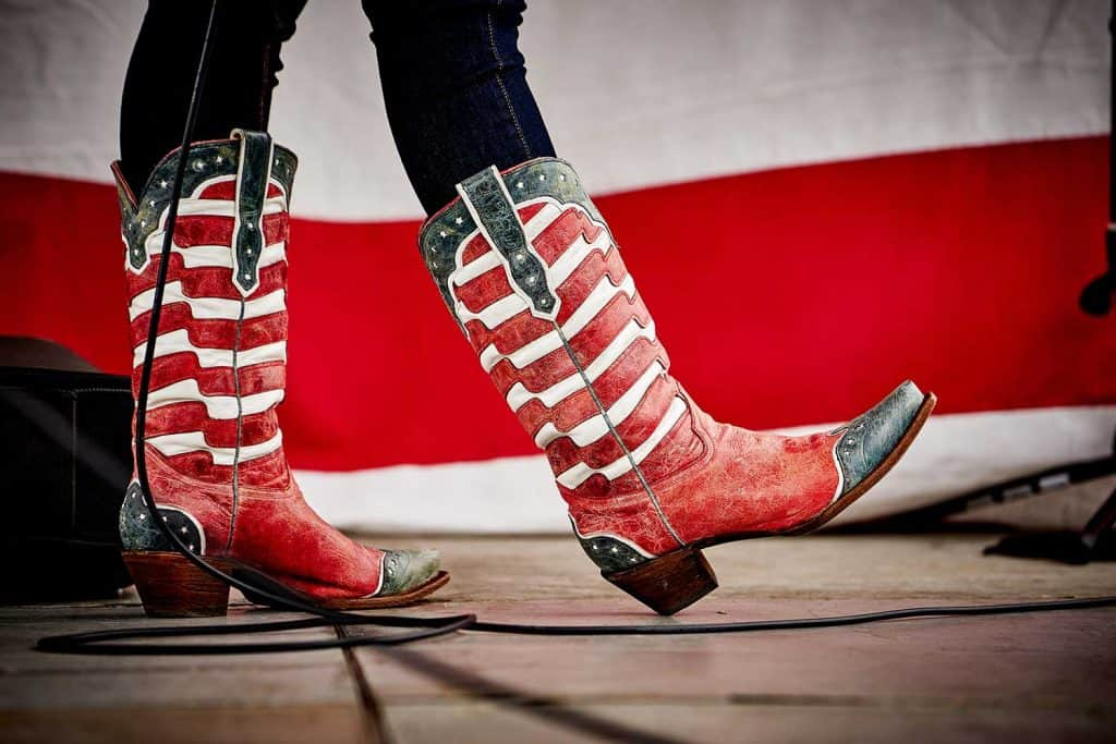 Woman wearing patriotic cowboy boots and jeans