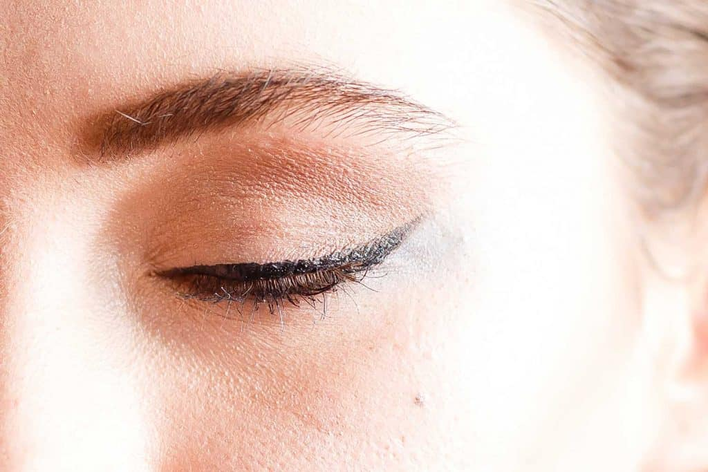 Woman with eyeliner and mascara
