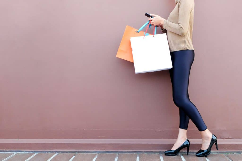 Women use smartphone shopping online , Fashion outfit stylish clothes wearing leggings, Are Leggings Appropriate For Work? [And Are They Business Casual?]