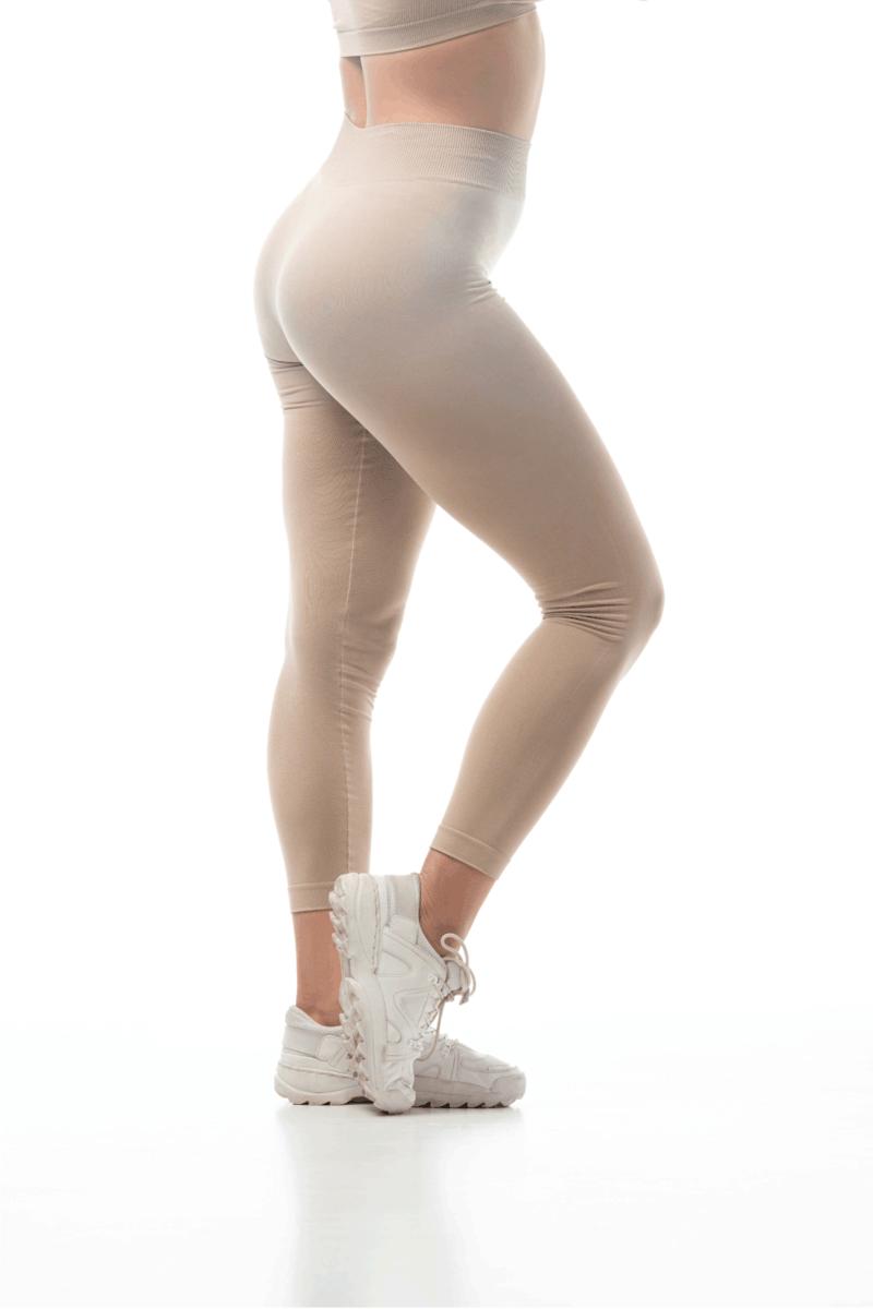 dancer in beige leggings posing in smoke isolated on white