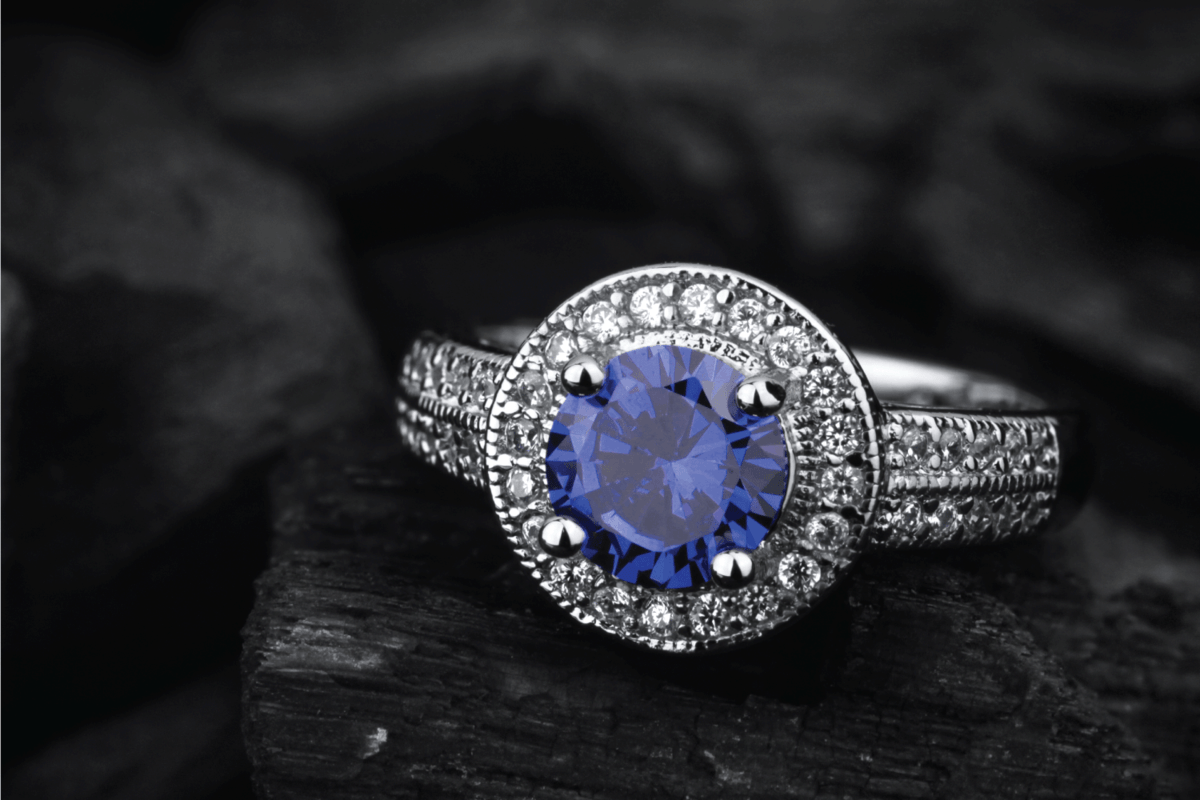 jewelry ring with big blue sapphire on black coal