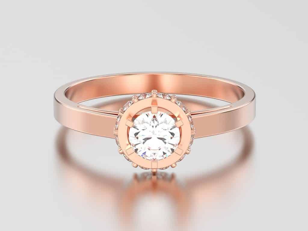 rose gold halo bezel pave diamond ring on a gray background