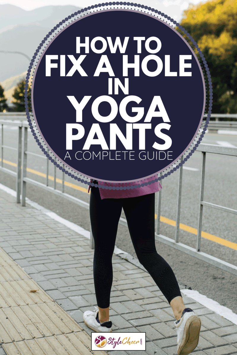 young woman running away on a sidewalk with steel rail barrier along a mountain highway. She's wearing pink hoodie and yoga pants. How To Fix A Hole In Yoga Pants [A Complete Guide]