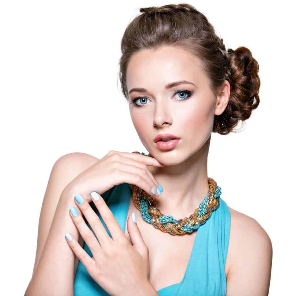 A beautiful woman wearing a light blue dress and light red colored lipstick
