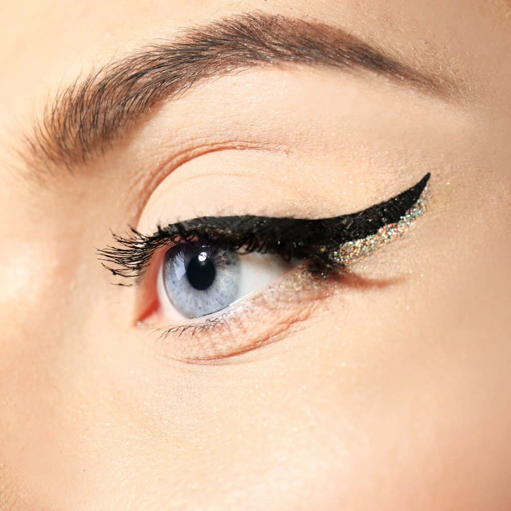 A gorgeous looking woman with a stylish eyeliner make design