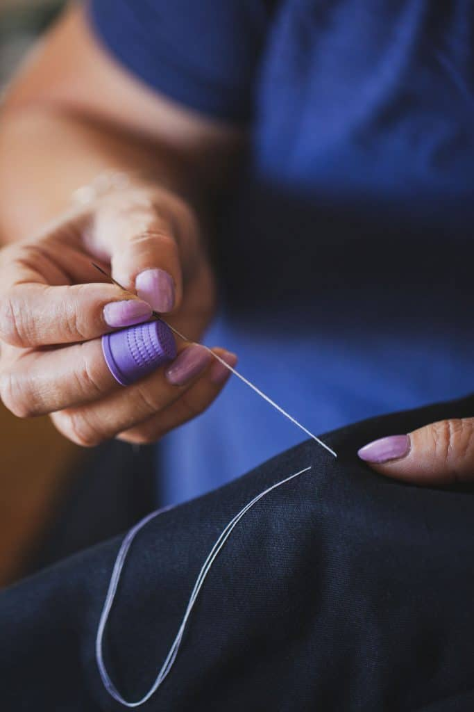 A woman sewing a skirt