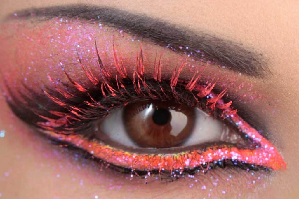 Beautiful woman with colorful eye makeup, Should Eyeliner And Mascara Match? [The Answer Might Surprise You!]