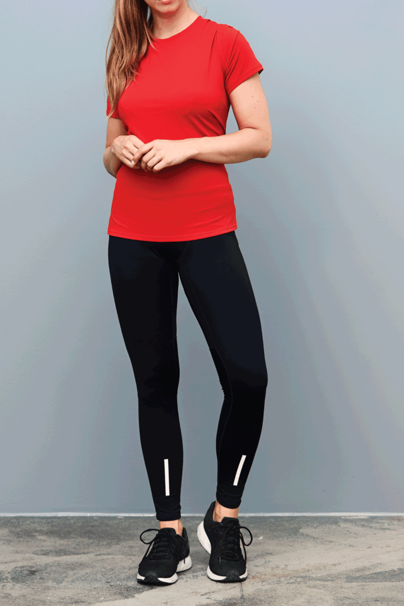 Beauty in sportswear, portrait of a woma wearing red shirt and black leggings