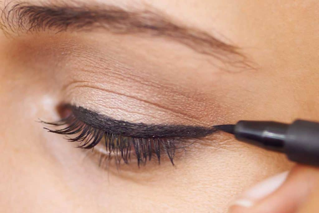 Close up of a young woman getting liner applied to her eyes, 11 Types Of Eyeliners To Know