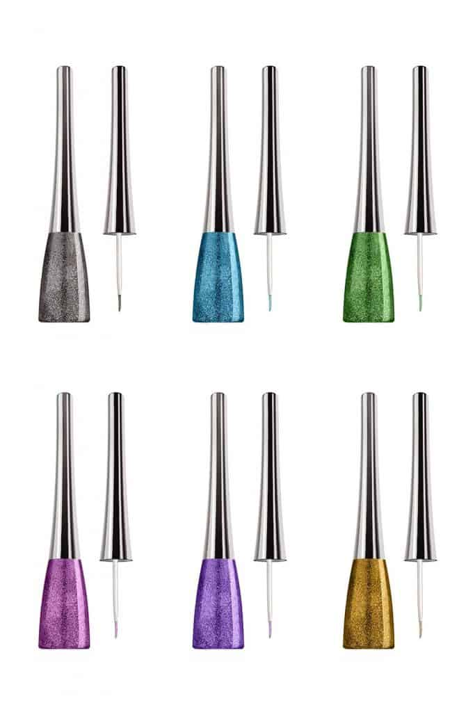 Cosmetic eyeliner thin brushes, set of six colors with glitter, beauty products isolated on white background