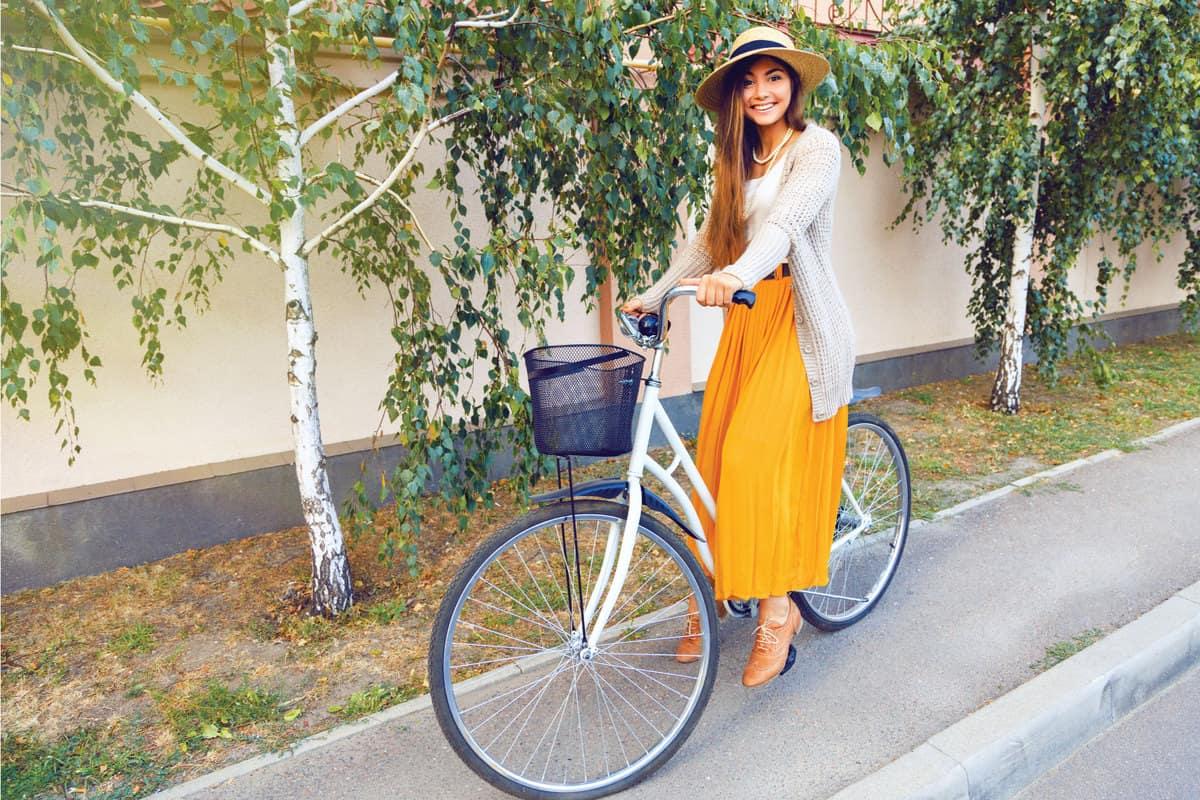 Elegant girl with hipster retro bike