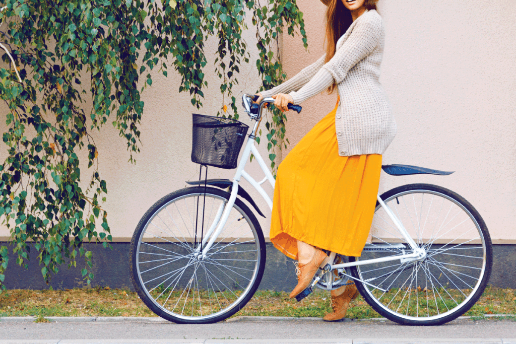 Hipster girl with retro bike outdoors, wearing maxi skirt and leather shoes. What Shoes To Wear With Maxi Skirt [Winter And Summer Options]