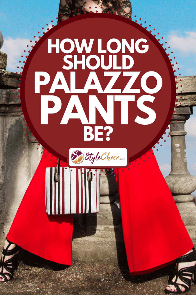 A woman standing on the bridge in pretty dress top and wide pants, handbag and heels, How Long Should Palazzo Pants Be?