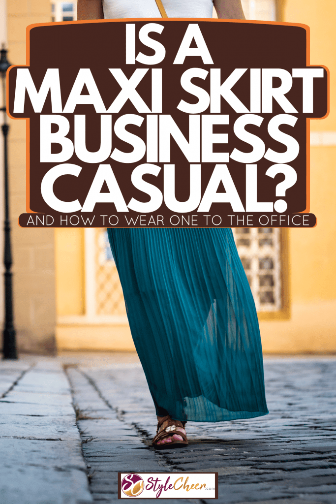 A woman wearing a Maxi skirt walking on the streets, Is A Maxi Skirt Business Casual? [And How To Wear One To The Office]