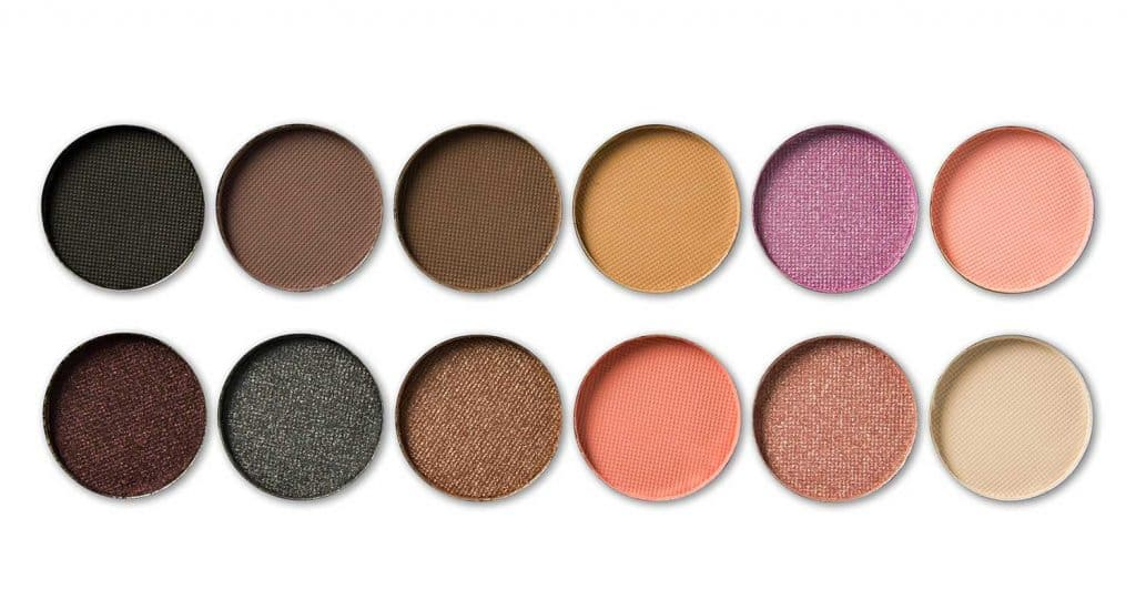 Palette of colorful eye shadows isolated on white background