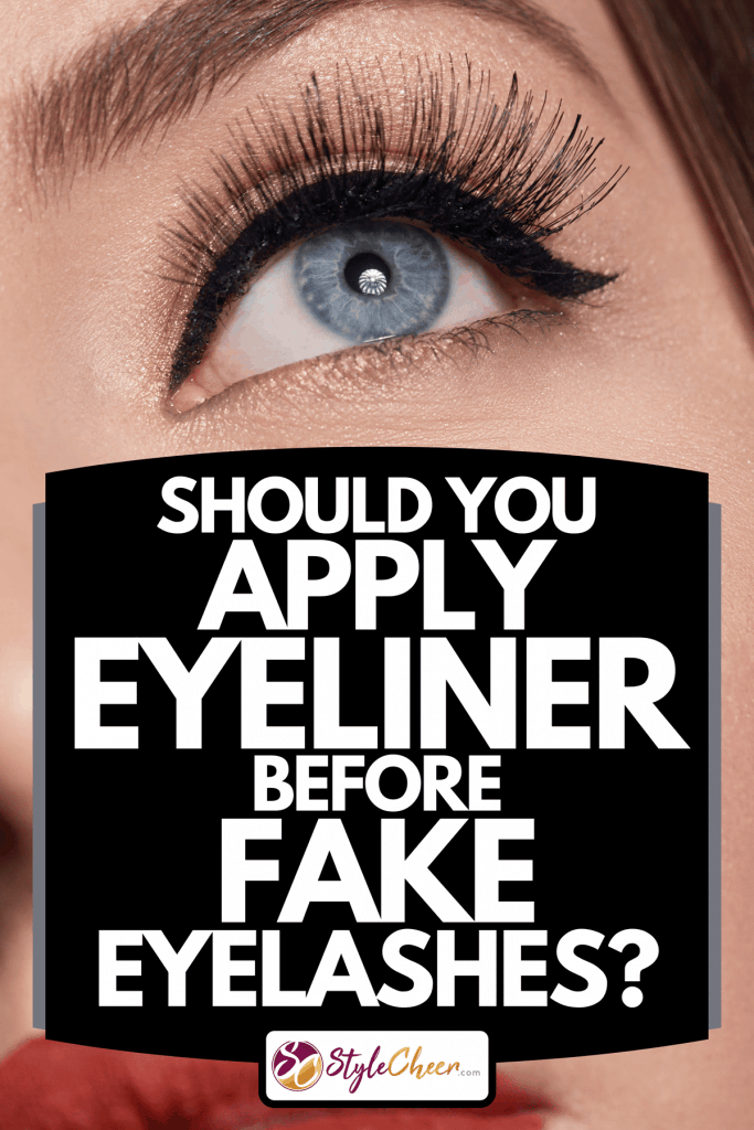 A woman with blue eye and red lips looking away, Should You Apply Eyeliner Before Fake Eyelashes?