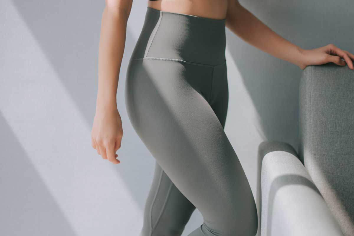 Side view mid section of a woman in yoga pants, How Tight Should Yoga Pants Be?
