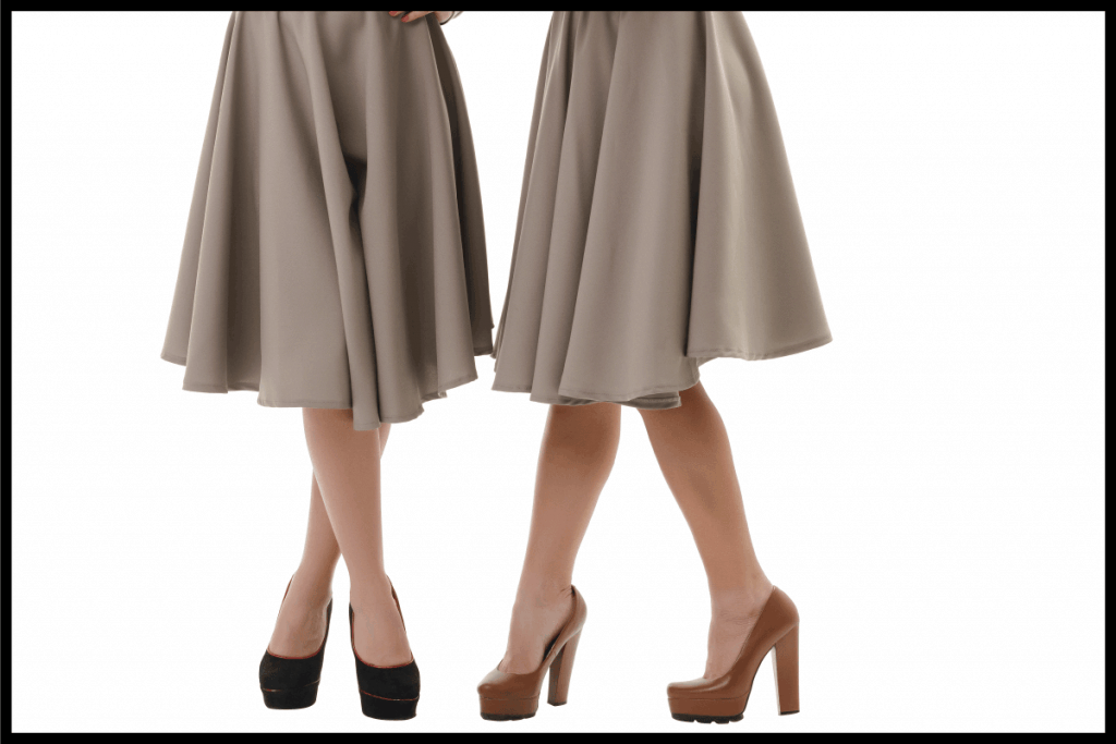 Smart young girls posing in studio with a book, wearing midi skirt and high heels. What Can You Wear With Midi Skirts [11 Outfit Ideas]