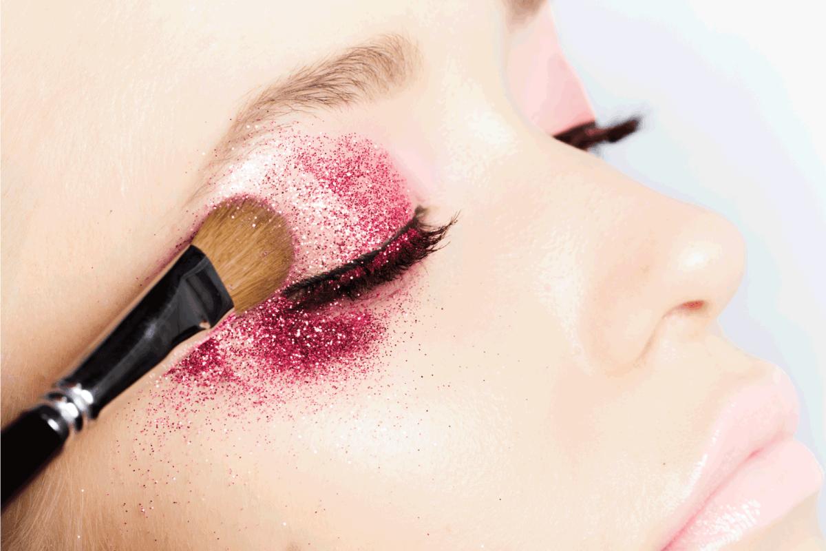 Woman applying eyeshadow, beauty make-up