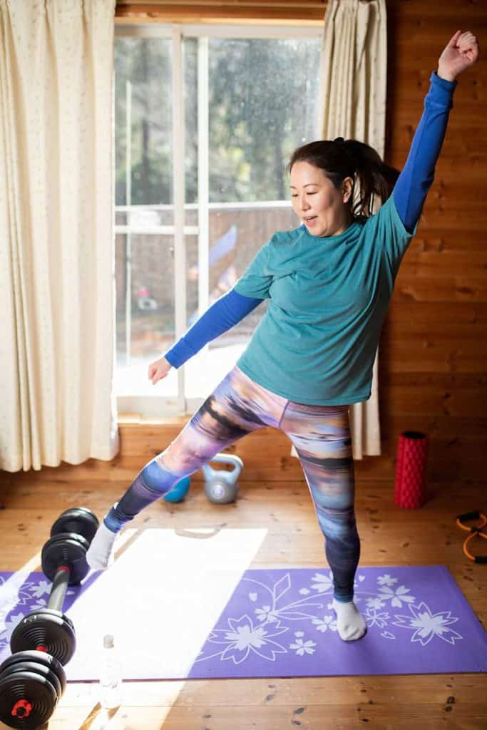 Woman exercising in her living room