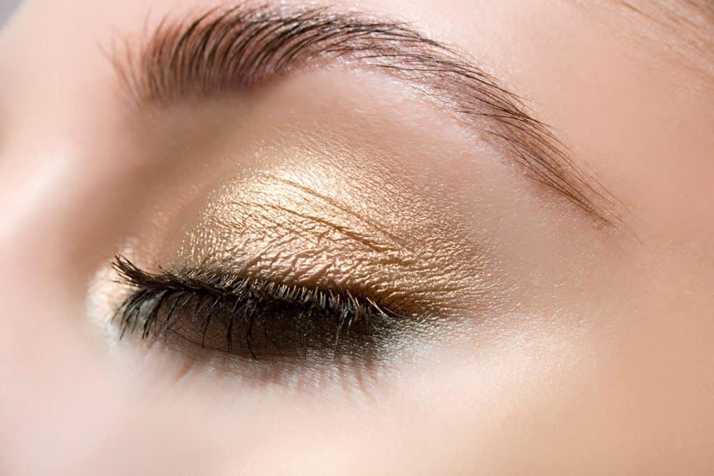 Woman wearing gold eye shadow
