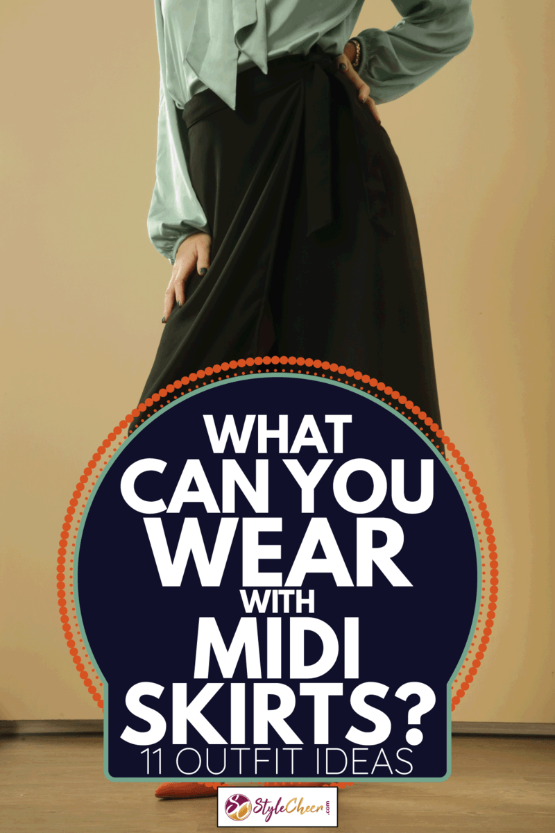 black A line midi skirt on unrecognizable model. What Can You Wear With Midi Skirts [11 Outfit Ideas]