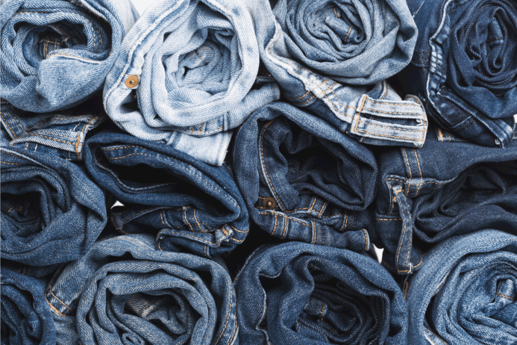 blue jeans rolled and stacked on top of each other. How To Make A Midi Skirt Out Of Jeans