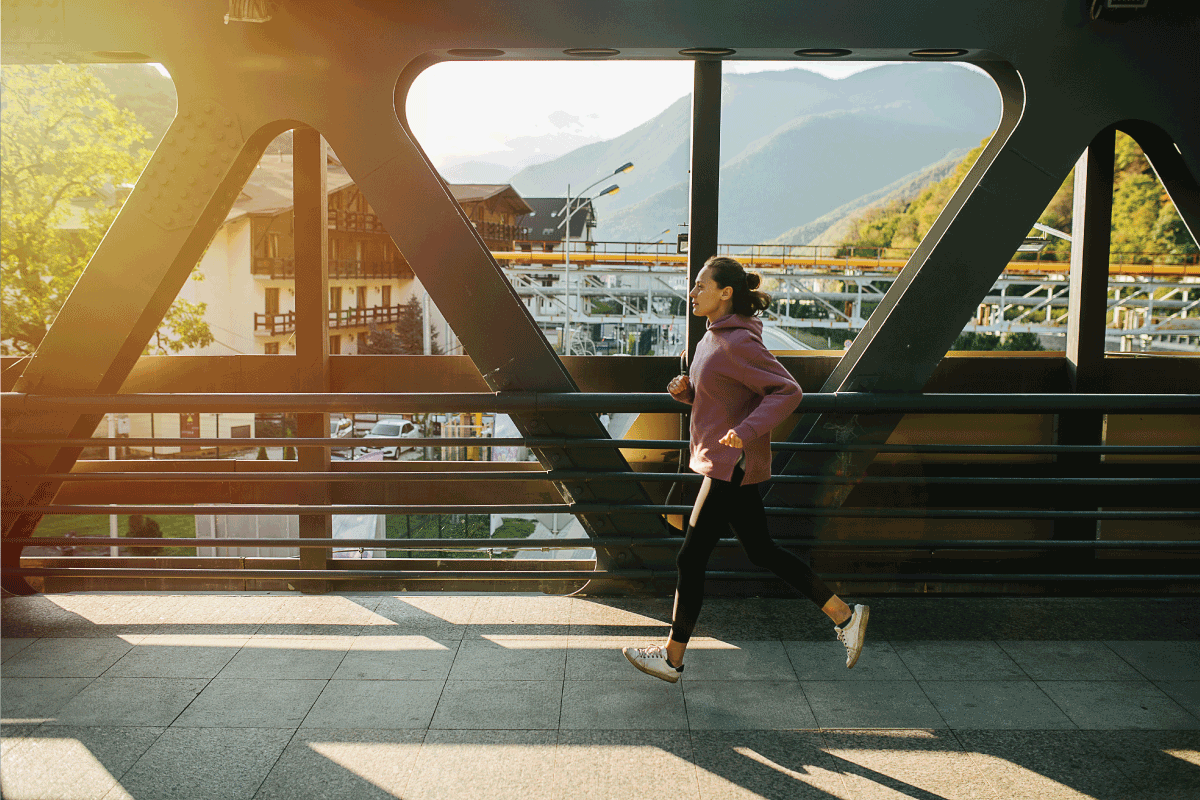 lady taking a short jog on a bridge wearing windbreaker and yoga pants. Are Yoga Pants Business Casual