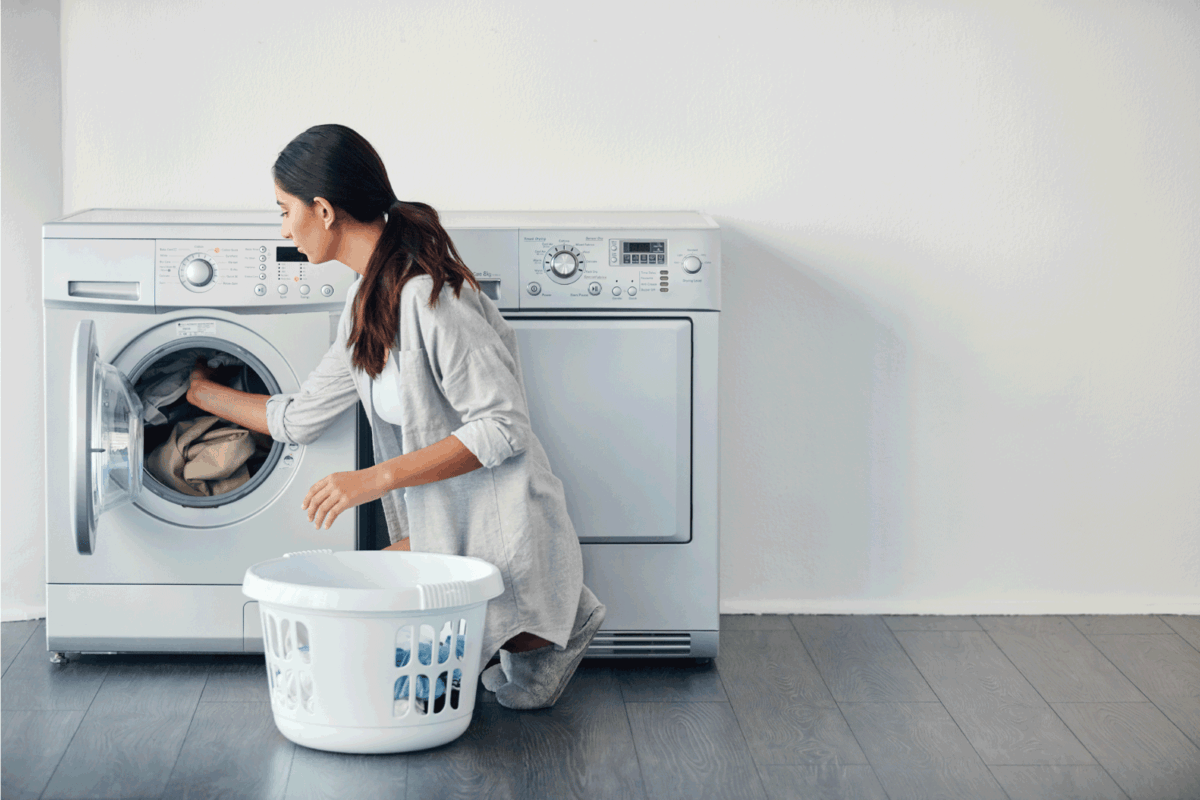 young attractive woman doing her laundry at home