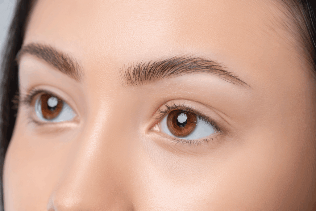 young teenager girl after plucking, hazel eyes. What Color Eyeliner For Hazel Eyes