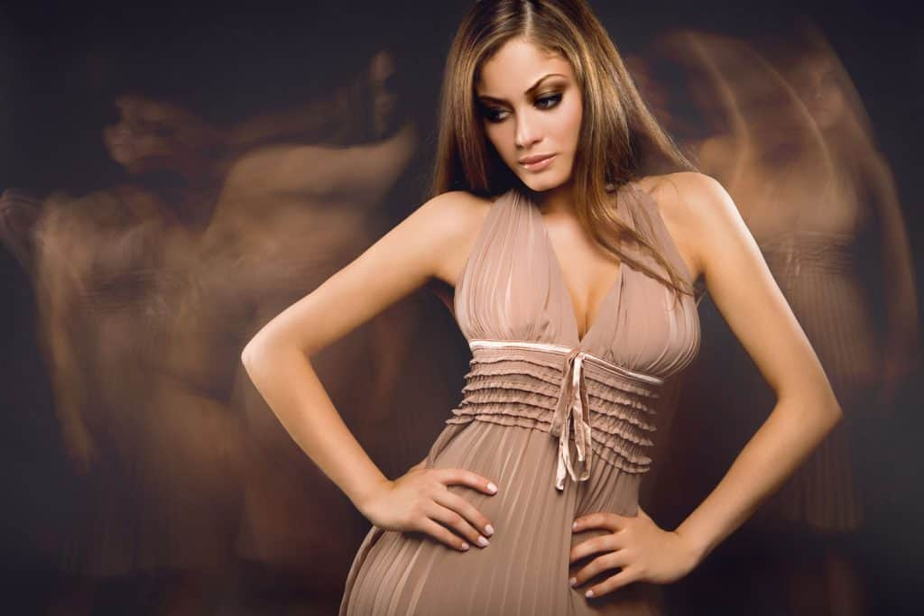 A blonde and beautiful woman wearing a brown dress and posing for a photoshoot, What Color Nail Polish With A Brown Dress?