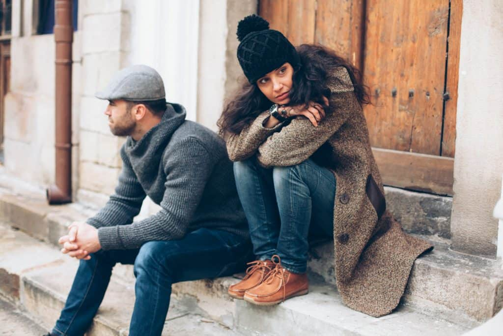 A couple wearing gray sweater, jeans, and brown shoes, What Color Shoes Go With Charcoal Outfits?