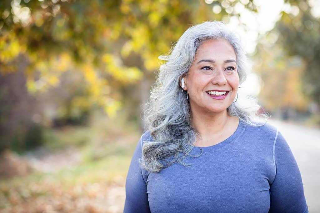 A beautiful senior woman with gray hair smiling
