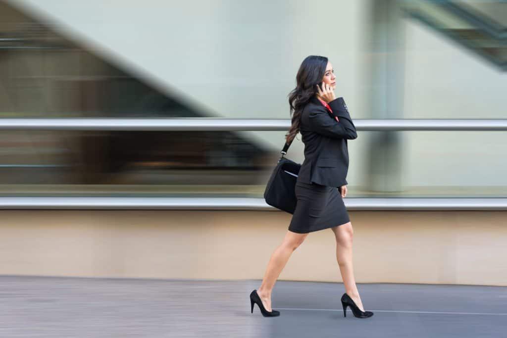A tall business woman wearing a proper business attire
