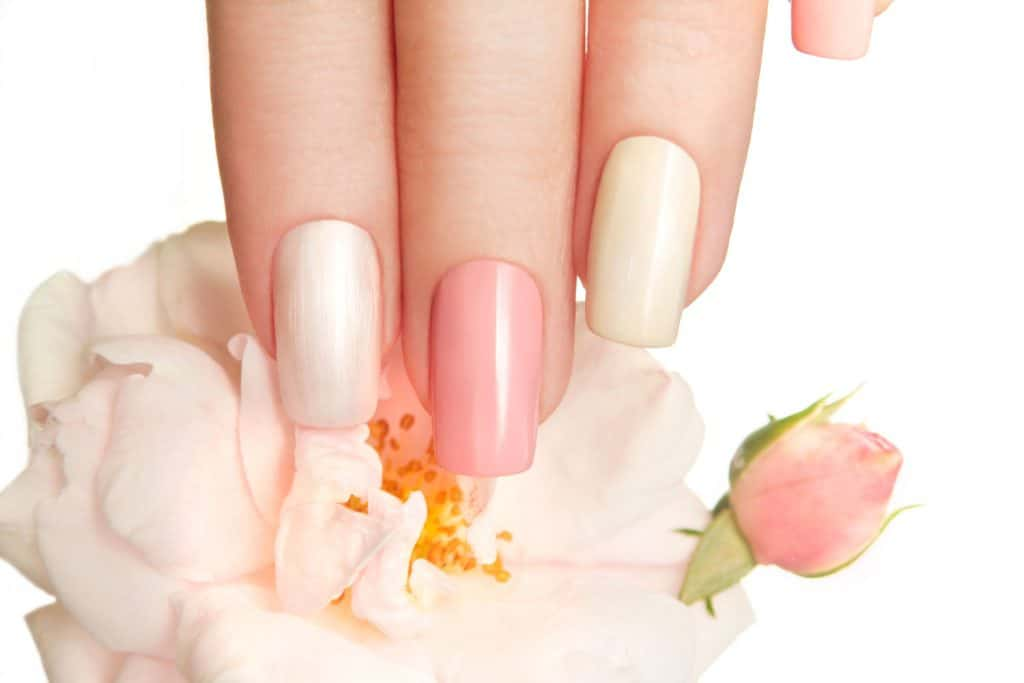 A woman showing her pale finger and gorgeous light tints of pink