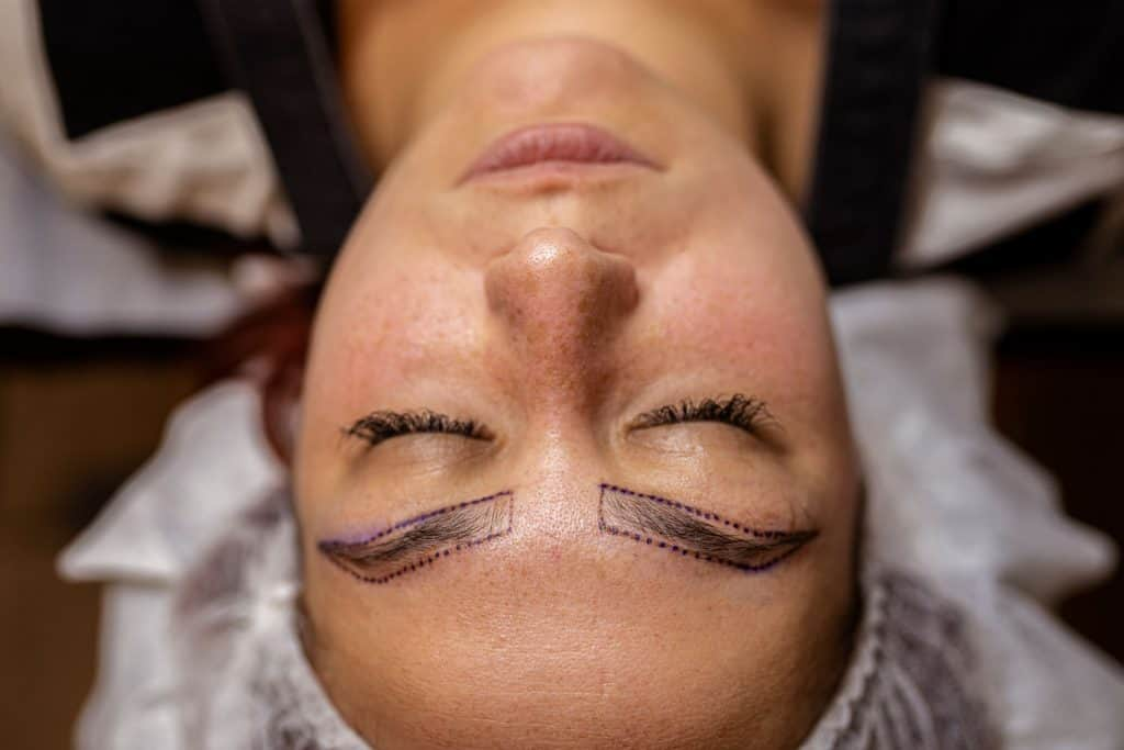 An up close photo of a woman getting her eyebrows done