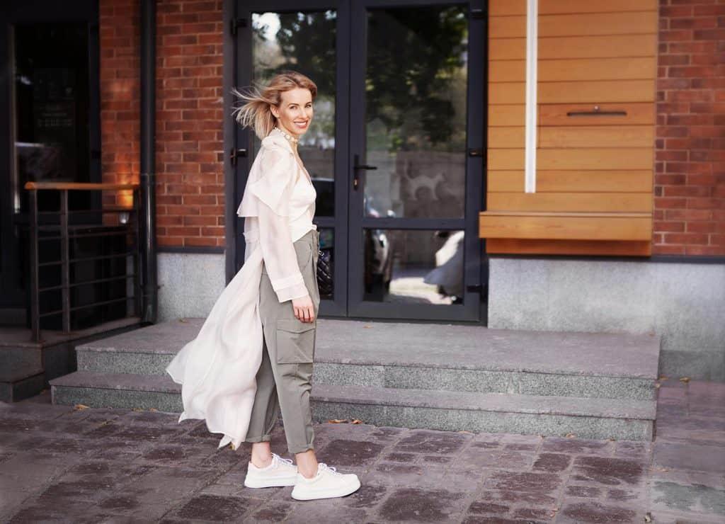 Beautiful fashion model smiling on city street
