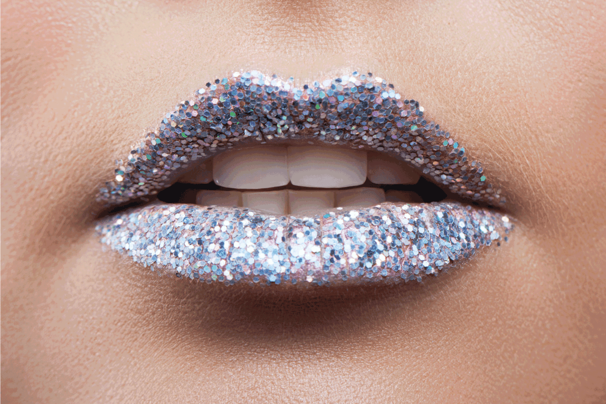 Beautiful female lips close-up. Lips in the sequins. Metal glitter.