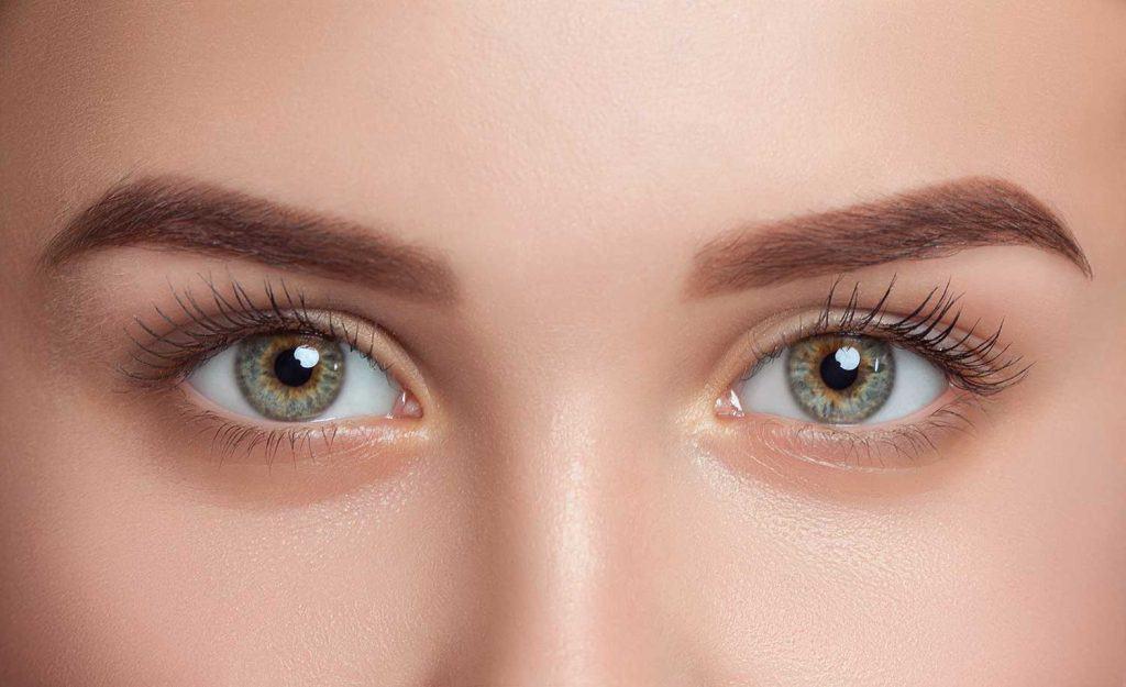 Beautiful woman with long eyelashes looking at the camera