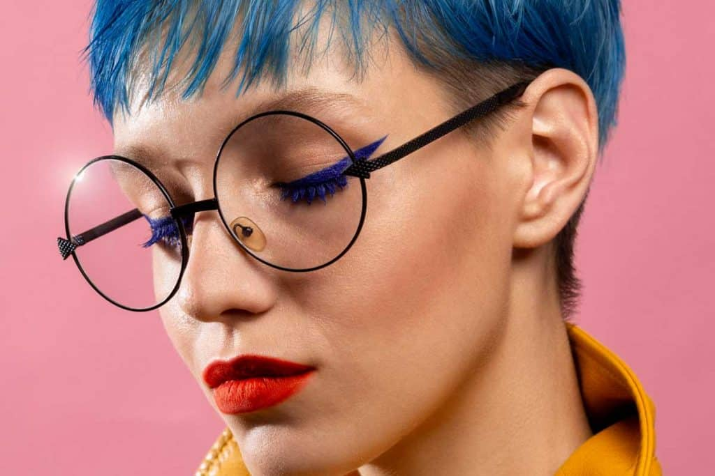 Blue-haired girl in round glasses wearing yellow jacket, What Color Lipstick Goes With Blue Hair?