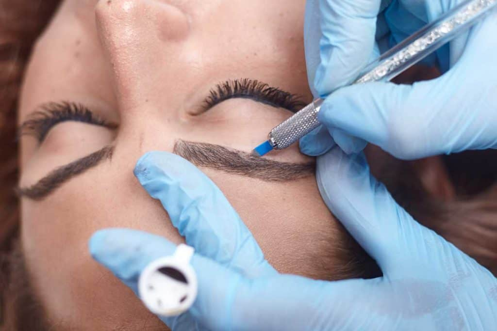 Close-up of hands microblading, adding pigment to eyebrows, Can Microblading Be Corrected?