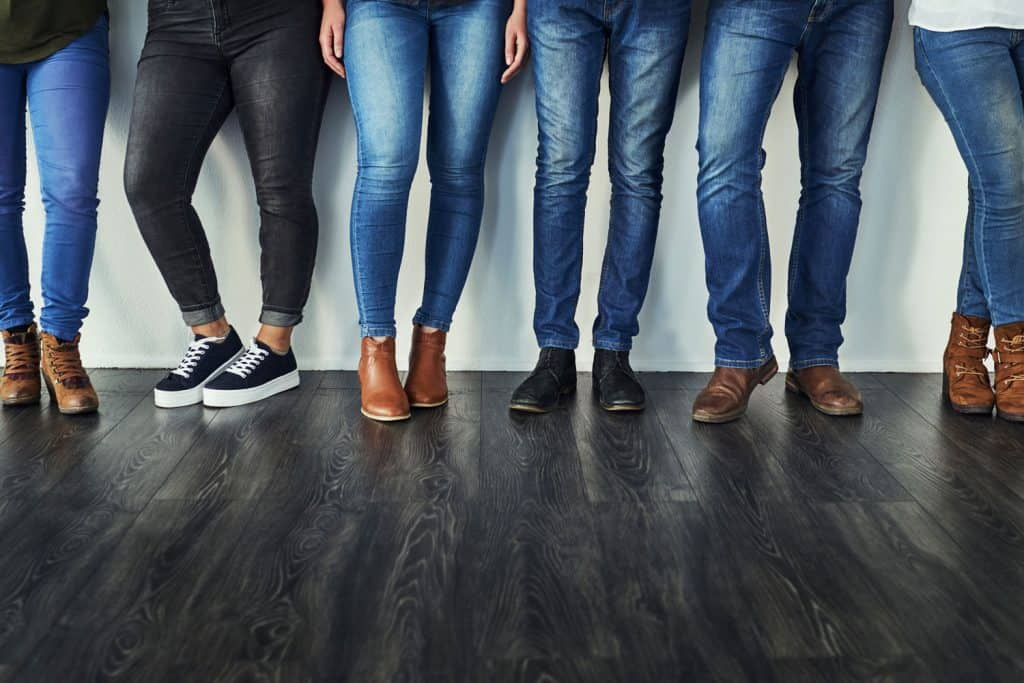 Cropped shot of a group of unrecognizable people wearing jeans while standing in a row, How Long Do Jeans Typically Last?