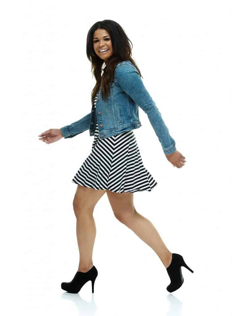 Fashionable woman wearing striped dress and denim jacket