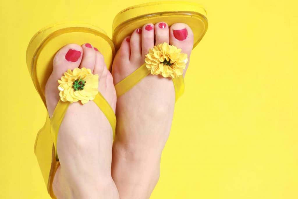 Feet with yellow flip flops and red nails, How To Personalize And Embellish Flip Flops - 11 Awesome Ideas With Pictures