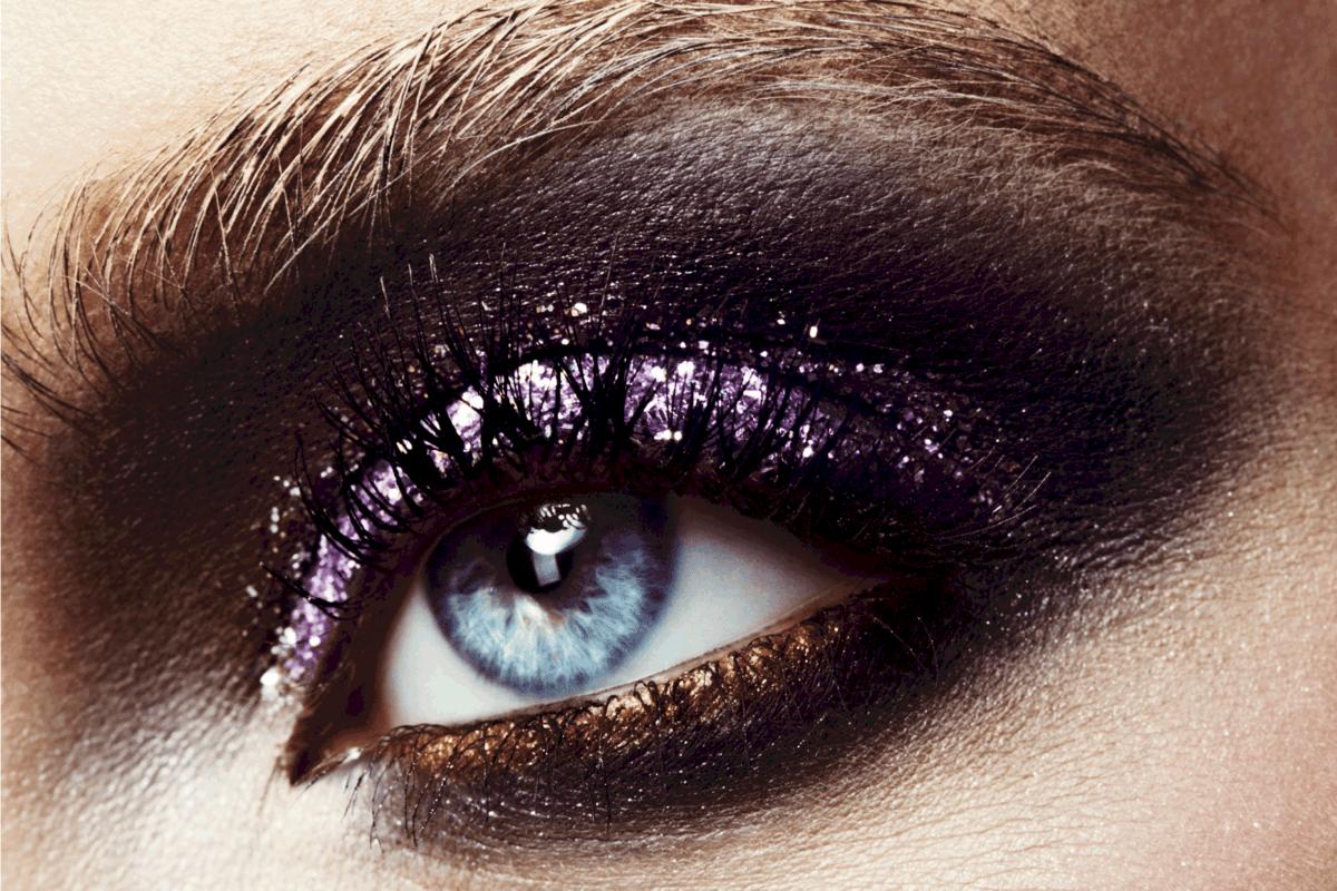 Female eye with professional bright shiny make-up.