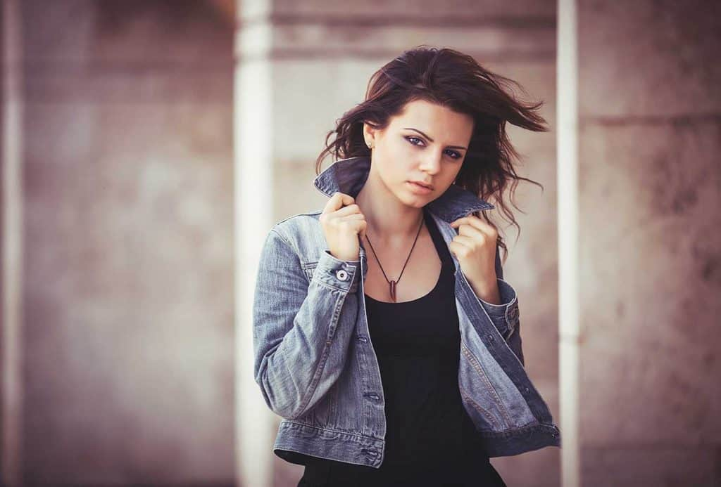 Girl in a black sleeveless and denim jacket